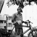 Man Standing By His Cycle Rickshaw @ India