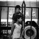 Two Boys In Front Of A Fence @ India