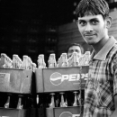 Man Standing Beside Bottles