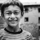 Boy Wearing Glasses And A Striped Shirt