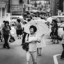 Smiling Woman Putting An Umbrella Up @ South Korea