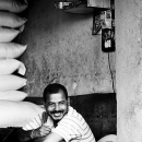 Smiling Man At The Counter @ India
