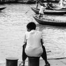 Boy Sitting On A Bollard