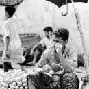 Keen Eyes Of A Man Selling Vegetables