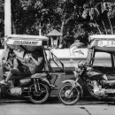 Two Trishaws Parked Beside Plaza Salcedo  @ Philippines