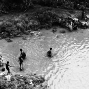 Figures In The Shallow Water Of The River @ India
