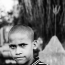 Piercing Look Of A Shaven-headed Boy @ India