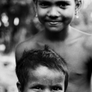 Smiling Little Boy And Girl With Pierced Ears @ India