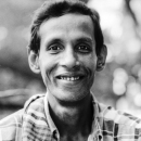 Grin Of A Man Riding On A Cycle Rickshaw @ Bangladesh