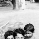 Three Kids Cuddling Close Together @ India