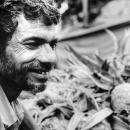 Man Smiled Beside Pineapples