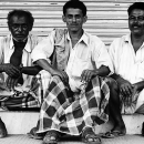 Three Men In Front Of The Shutter @ India