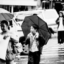 Boy Putting An Umbrella Up @ Philippines