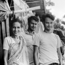 One Woman And Two Men In Front Of A Shabby House @ Bangladesh