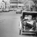Man Sleeping On A Pedicab