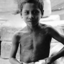 Boy Holding A Piece Of Bread @ Bangladesh