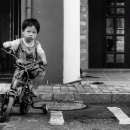 Boy On The Bicycle With Training Wheels