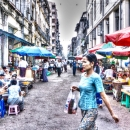 Pony-tailed Woman And Street Booths In Yangon