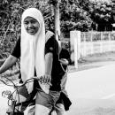 Two Girls Wearing Hijab On The Bicycle @ Malaysia