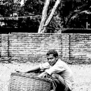 Man And Baskets In An Empty Lot @ Bangladesh