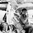 Man And Umbrella On A Cycle Rickshaw