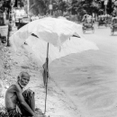 Man And Umbrella By The Roadside @ Bangladesh