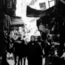 Black Hijab In The Crowded Lane