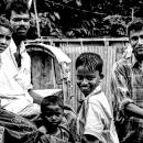 Men And Boys Around A Cycle Rickshaw