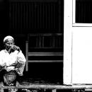 Man Crouching At The Entrance