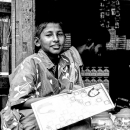 Boy Under The Eaves Of A General Store