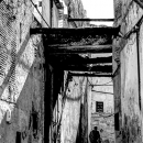Figure Walking The Narrow Alley