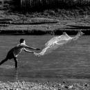 Boy Throwing A Net In Nam Khan River