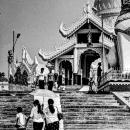 Three Persons Heading For Pagoda