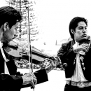 Two Men Playing Violin
