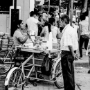 Man Standing Beside A Food Stall