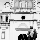 Man Carrying Hammocks And Santo Domingo Church