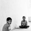 Two Boys Sitting In The Passage