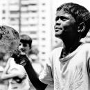 Boy Holding A Racket