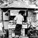 Man Buying At A Kiosk