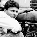 Young Man Beside A Mtorcycle