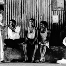 Men Relaxing In The Dimness @ India