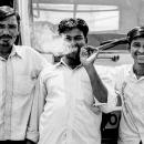 Three Men And Cigarette Smoke