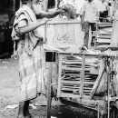 Man Wearing A Lungi And  His Cart