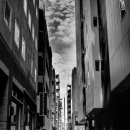 Woman Between The Buildings