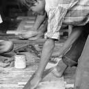 Young Man Sawing Timber