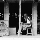 Man Resting In The Storefront
