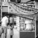 Girl In Front Of The Food Stall