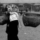 Woman Carried Baskets On A Pole