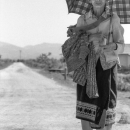 Older Woman On The Unpaved Road