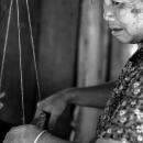 Female Weaver Was Working